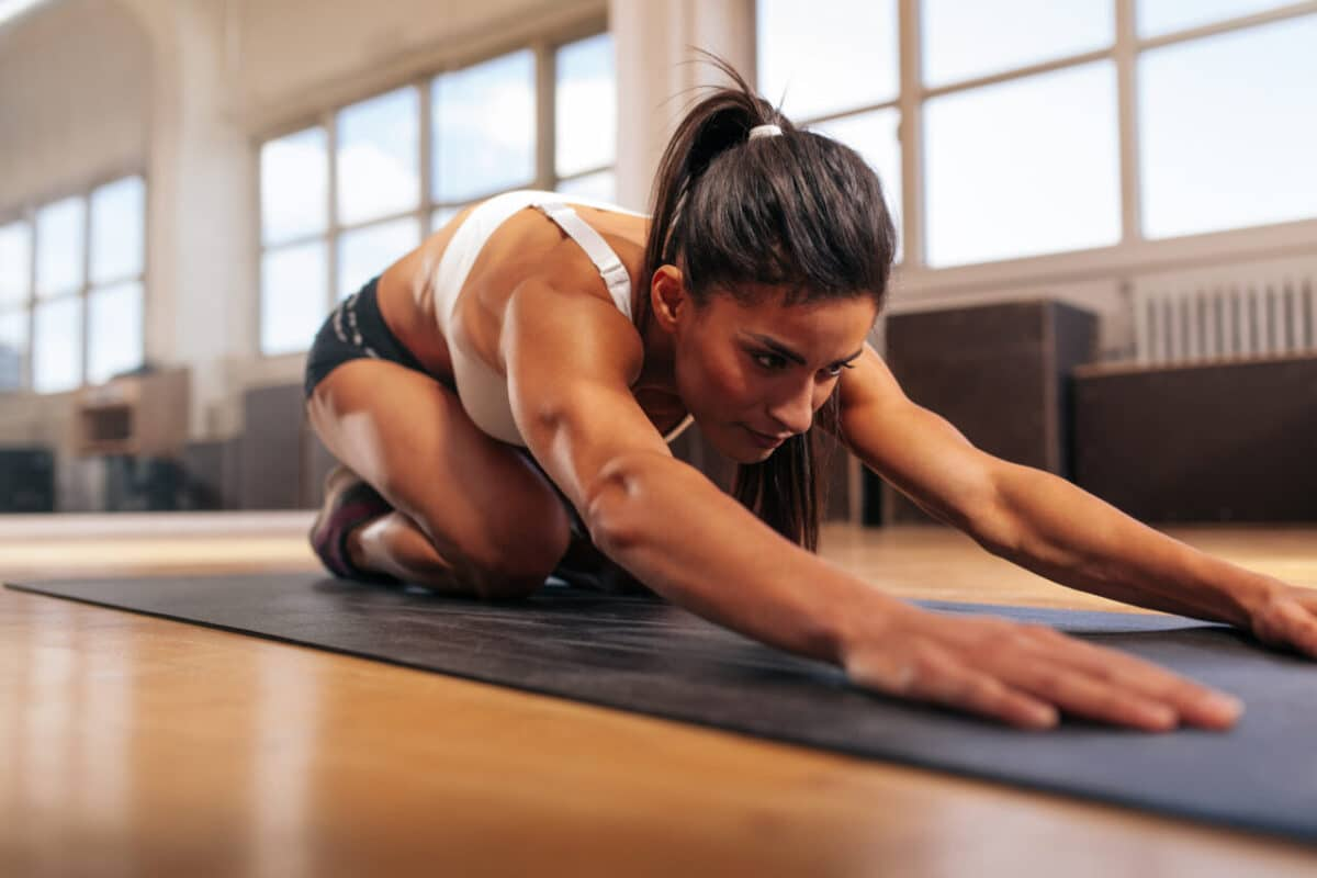 muscular woman stretching
